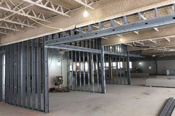 New walls are starting to go up, and fireproofing material has been applied to the ceilings.